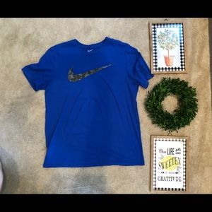 Gently used blue Nike with camo swoosh t-shirt.